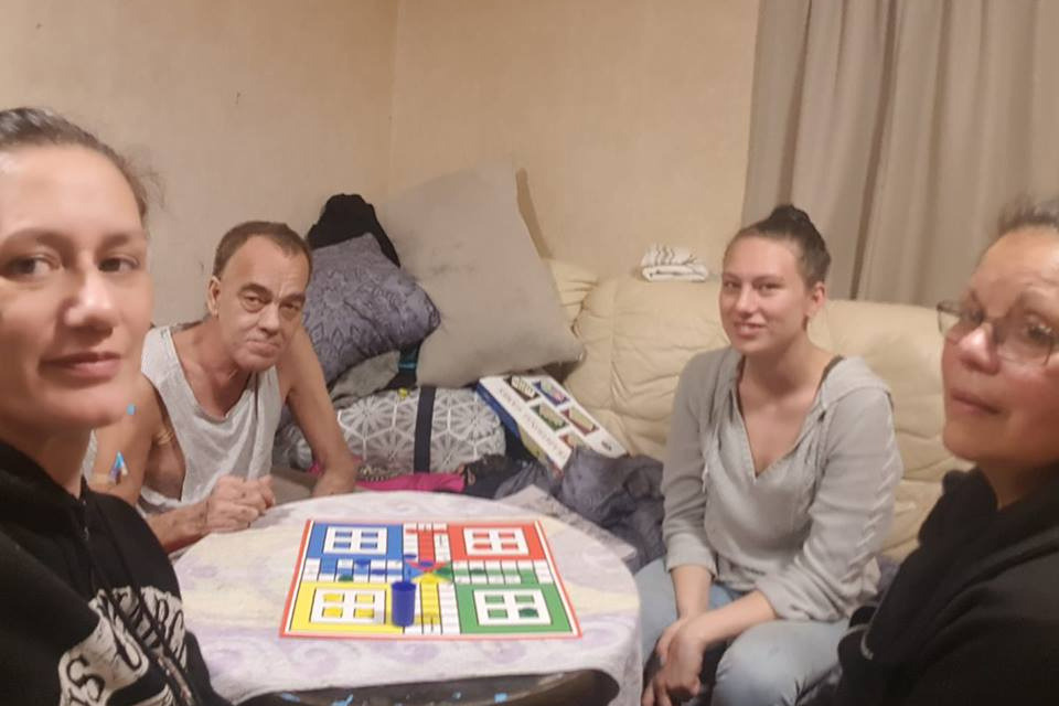 Leroy & Family Playing Board Games